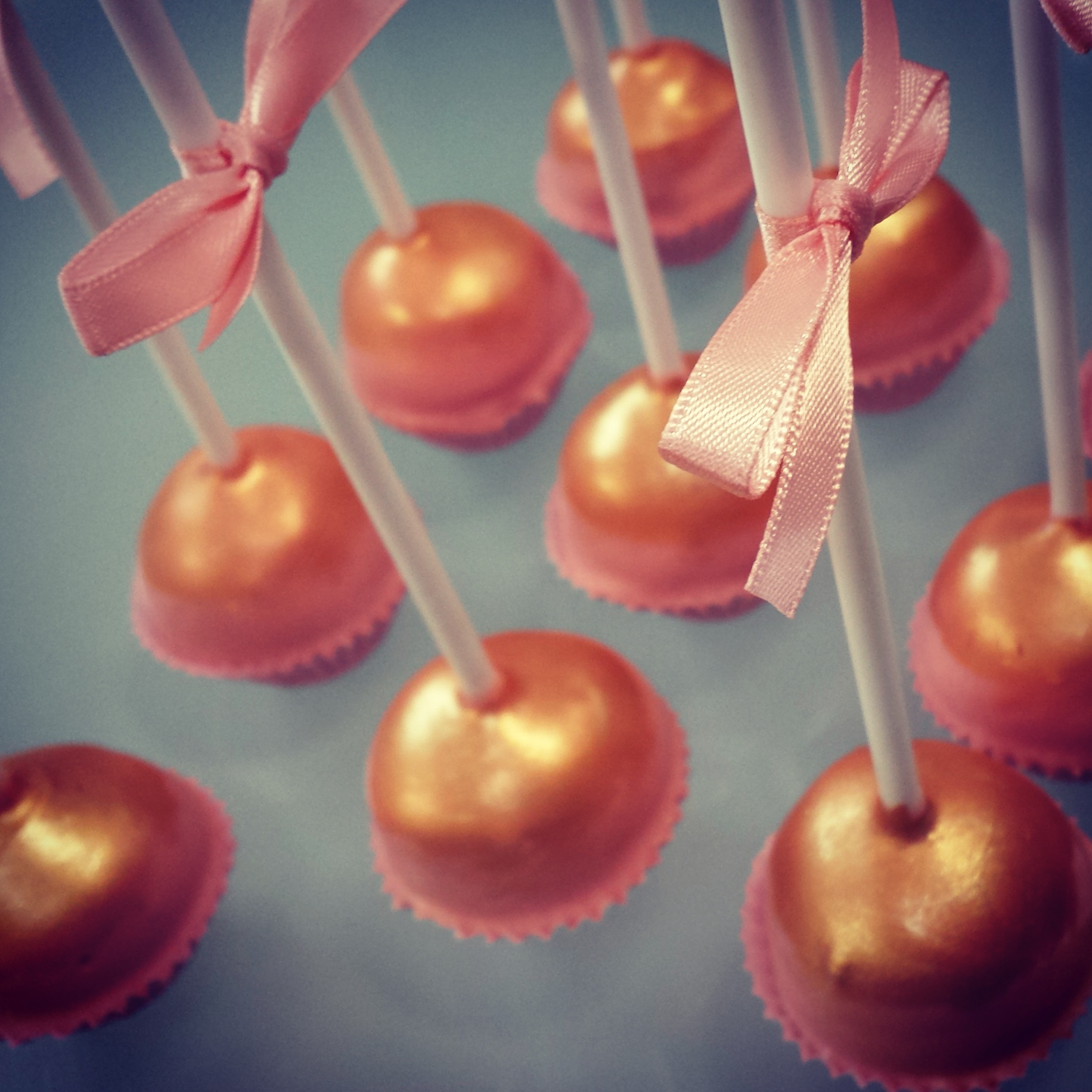 Pink and gold wedding favour cake pops
