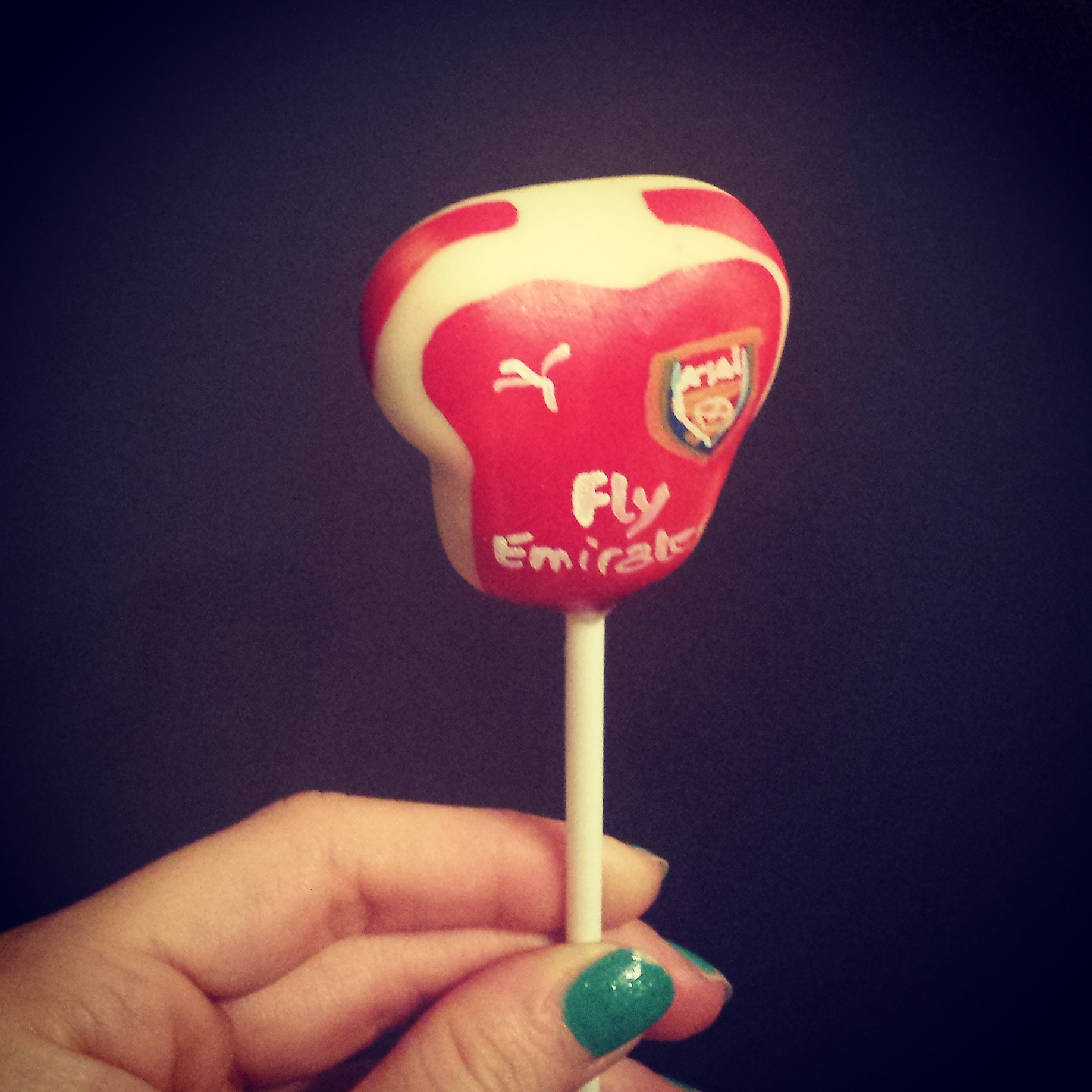 Delish Arsenal football kit cake pop